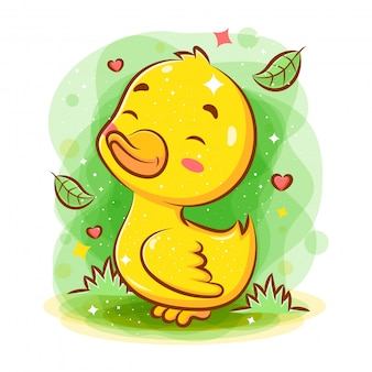 Mignon bébé canard souriant jouer dans le jardin