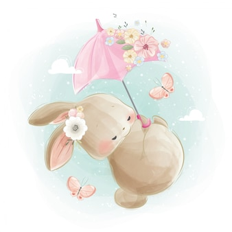 Mignon bébé lapin volant avec un parapluie pinky