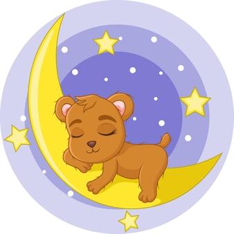 Mignon bébé ours endormi sur la lune