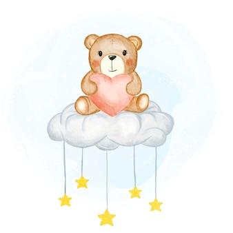 Mignon bébé ours tenant la forme de l'amour assis sur l'illustration aquarelle de nuages étoilés
