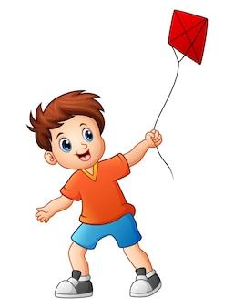 Mignon garçon jouant au cerf-volant