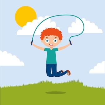 Mignon garçon jouant la corde à sauter dans le parc