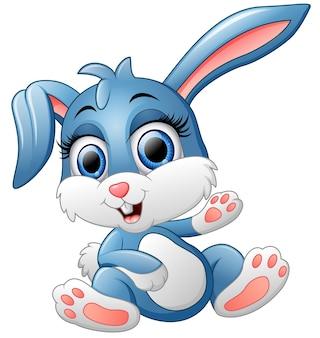 Mignon lapin agitant la main