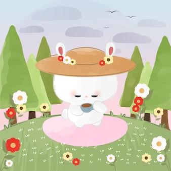 Mignon petit bunny tea time par une journée ensoleillée