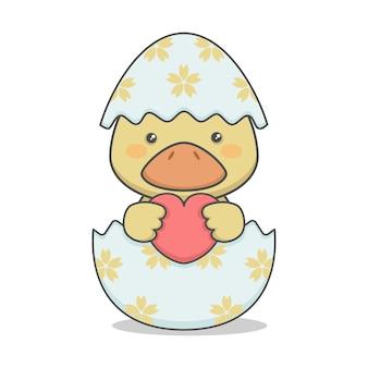 Mignon petit canard dans un oeuf de pâques
