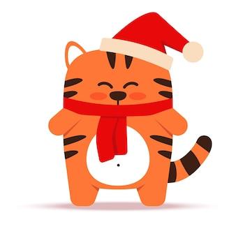 Mignon petit chat tigre orange dans un style plat. le symbole du nouvel an chinois 2022. animal avec bonnet et écharpe de noël. le tigre est debout. pour bannière, décor de pépinière. illustration vectorielle.
