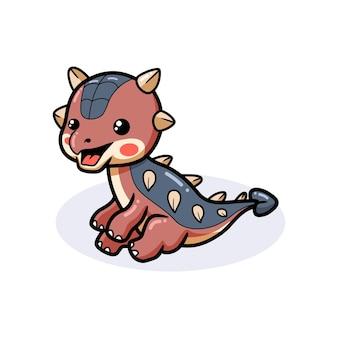 Mignon petit dessin animé de dinosaure ankylosaure assis