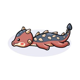 Mignon petit dessin animé de dinosaure ankylosaure avec couché