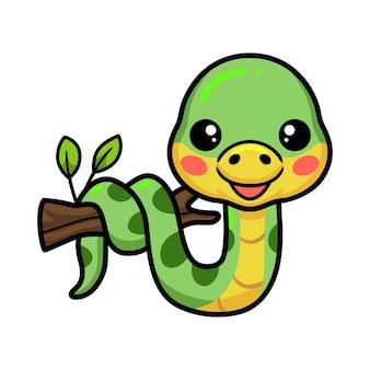 Mignon petit dessin animé de serpent vert sur une branche d'arbre
