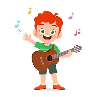 Mignon Petit Garçon Joue De La Guitare En Concert Vecteur Premium