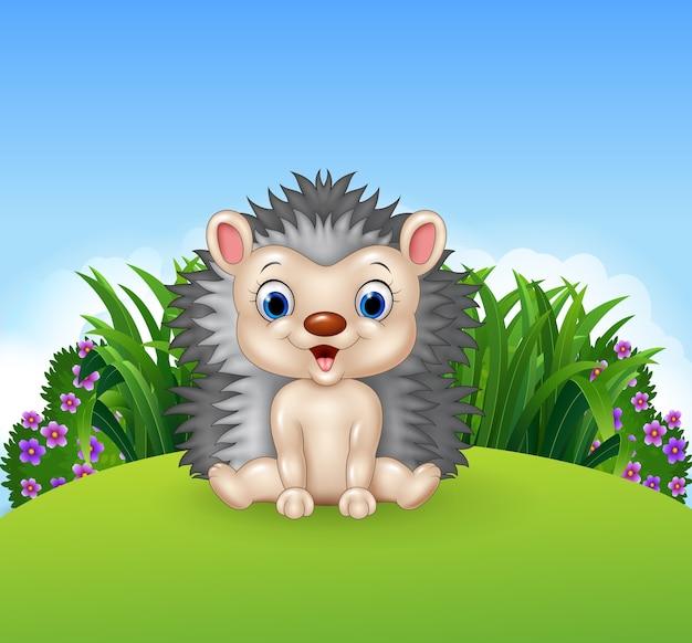 Mignon petit hérisson assis sur la jungle