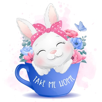 Mignon petit lapin assis dans une tasse