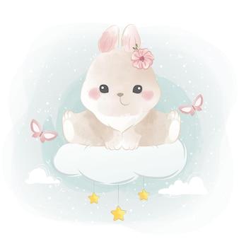 Mignon petit lapin assis sur un nuage