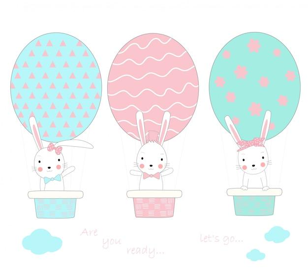 Le mignon petit lapin avec un ballon en forme d'oeuf