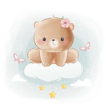 Mignon petit ours assis sur un nuage