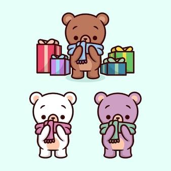 Mignon petit ours portant écharpe et environnement par chritmas présent