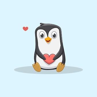 Mignon petit pingouin tenant un coeur rouge