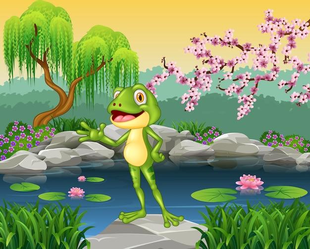 Mignon petit prince grenouille présentant