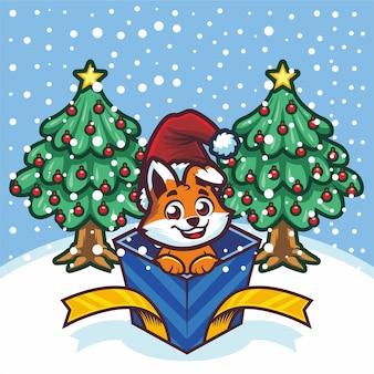 Mignon petit renard en boîte-cadeau à noël