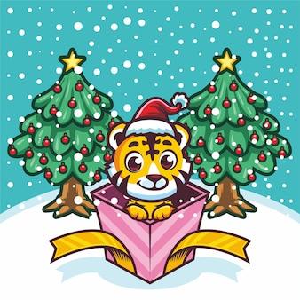 Mignon petit tigre en boîte-cadeau à noël