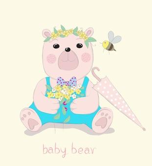 Mignonne petite caricature d'ours tient des fleurs à la main.