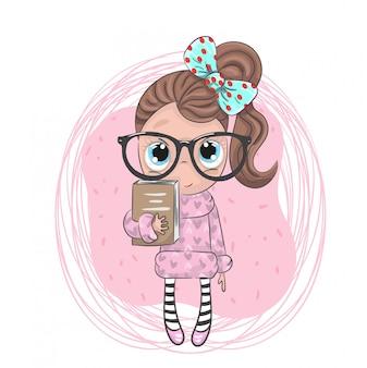 Mignonne petite fille tenant le livre de dessin animé dessinés à la main