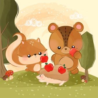Mignons petits animaux mangent des pommes