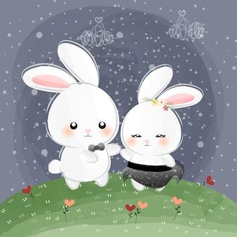Mignons petits lapins dansant dans la nuit
