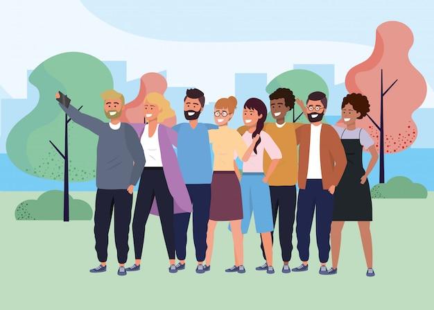 Millénaire groupe diversifié prenant selfie à l'extérieur