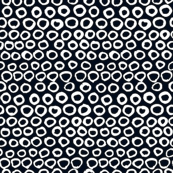 Modèle artistique sans soudure de vecteur. points de griffonnage dessinés à la main, cercles blancs sur fond noir. utiliser pour le design, les cartes, le tissu, la décoration, etc.