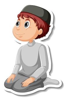Un modèle d'autocollant avec un garçon musulman priant