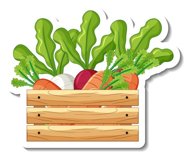 Modèle d'autocollant avec des légumes racines dans une boîte en bois