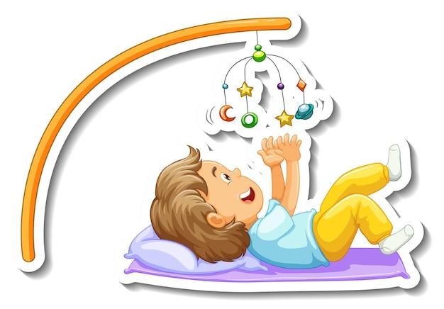 Modèle d'autocollant avec une petite fille jouant au bébé mobile isolé