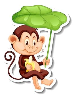Modèle d'autocollant avec un singe tenant une feuille sur fond blanc