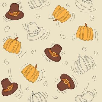 Modèle d'automne sans couture. chapeau et citrouille - icônes de thanksgiving dessinés à la main