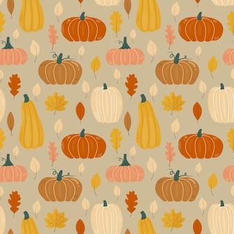 Modèle d'automne sans couture avec des feuilles de chêne et d'érable citrouilles