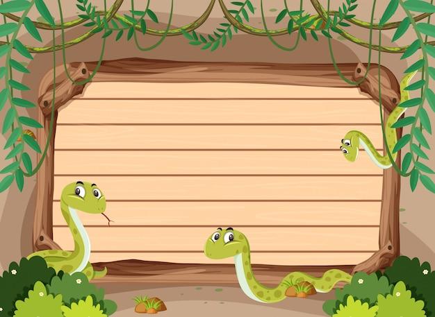 Modèle de bannière avec des serpents dans la jungle