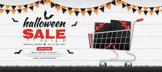 Modèle de bannière de vente halloween panier avec des boîtes de cadeau