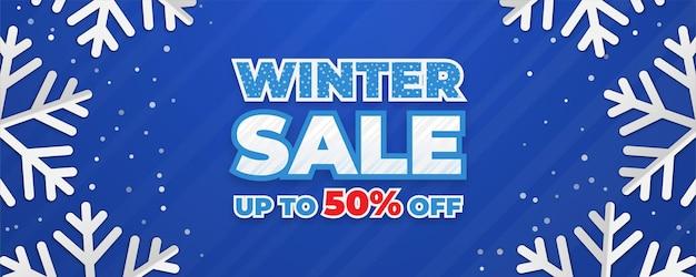 Modèle de bannière de vente d'hiver avec des flocons de neige épars sur fond bleu