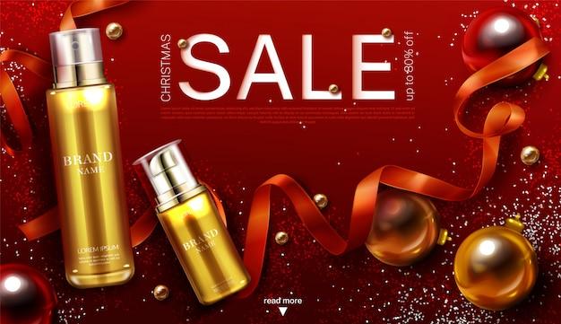 Modèle de bannière de vente de noël de cosmétiques, tubes de pompe cosmétique or de produit de beauté cadeau avec ruban de boules de décoration festive et scintille.