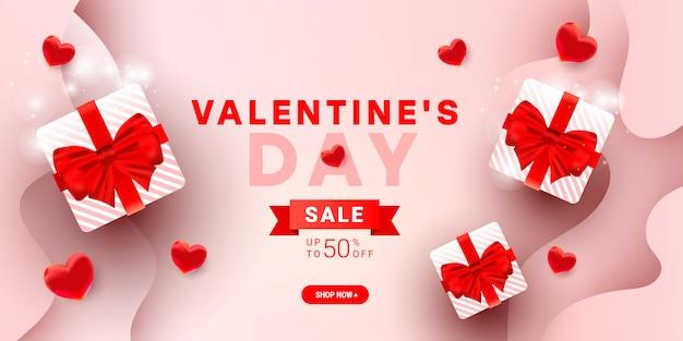 Modèle de bannière de vente de saint valentin avec des coffrets cadeaux surprise, décor d'éléments de ballon coeur 3d et ruban sur dégradé