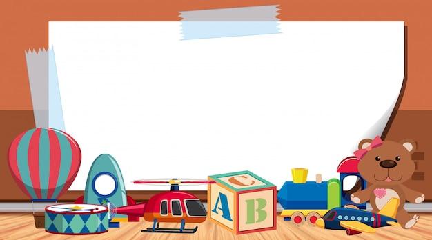 Modèle de bordure avec de nombreux jouets sur le sol