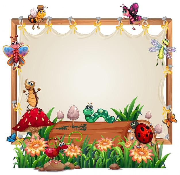 Modèle de cadre en bois de toile avec animal dans le jardin isolé