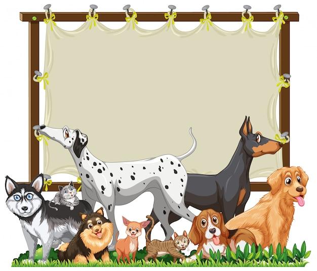 Modèle de cadre en bois de toile avec groupe de chiens mignons isolé