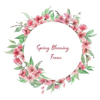 Modèle de cadre de cercle aquarelle dessiné à la main avec des branches de cerisier en fleurs