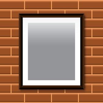 Modèle de cadre photo isolé sur fond de mur de brique