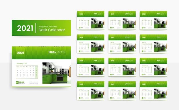 Modèle de calendrier de bureau créatif 2021 pour société immobilière avec couleur verte
