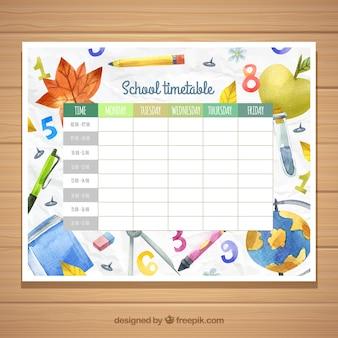 Modèle de calendrier scolaire avec des matériaux aquarelles