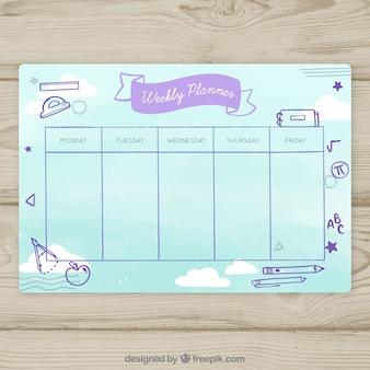 Modèle de calendrier scolaire en style dessiné à la main