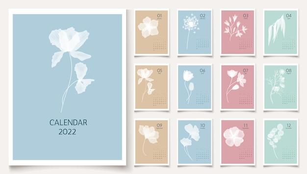 Modèle de calendrier vertical mural floral 2022 avec des plantes d'herbes de fleurs blanches
